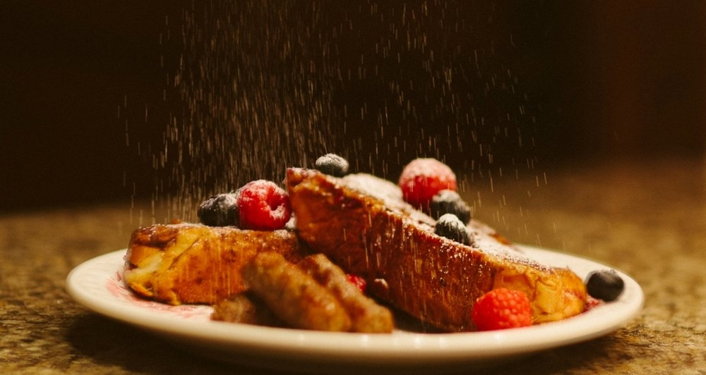 Dusting the French Toast with Powdered Sugar.jpg