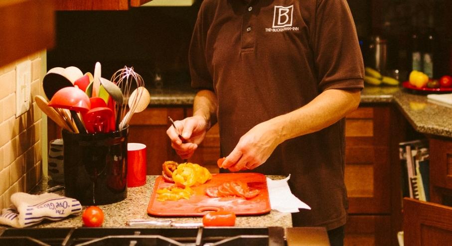 Chef Slicing Tomatoes for Egg Frittata.jpg