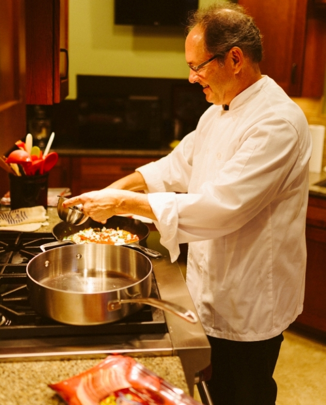 Chef Adding Herbs to Breakfast Frittata.jpg