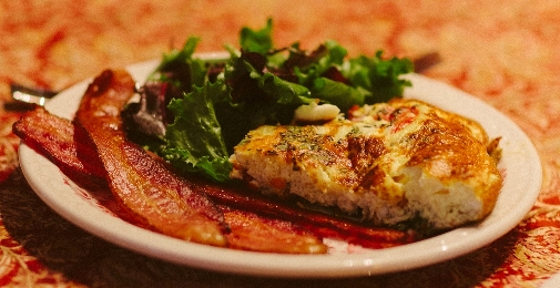Egg Frittata Served with Bacon and Fresh Greens.jpg