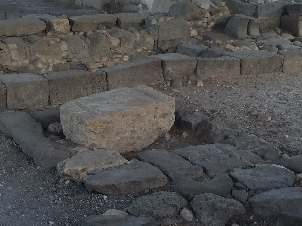 This area was for studying. It is off to side of the tabernale entrance. The two grooves on the side were for holding the wooden dowls of a scroll.