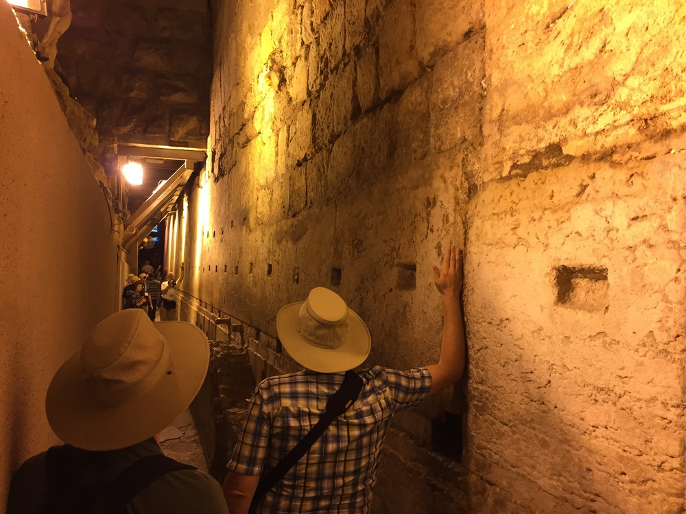 When everyone was done at the Wailing Wall, Gus led us down a stairwell to a tunnel that ran directly underneath the street we had been standing on, that ran alongside the length of the western wall. At one point the wall touched bedrock of Mt. Moriah! The average sized stone in the foundation is 2.5 tons, but the one in this picture is one solid piece. The two men in the picture are marking the length of the stone with their arms. It is 45 feet long, nearly 10 feet tall, with an estimated weight of 570 tons! During our walk in this tunnel we watched a video presentation on ancient methods of moving stones like this. There were several more cisterns along the way, until we reached the Wailing Wall Cistern at the North Western corner of the Temple Mount. We then took a flight of stairs back up to the street level.