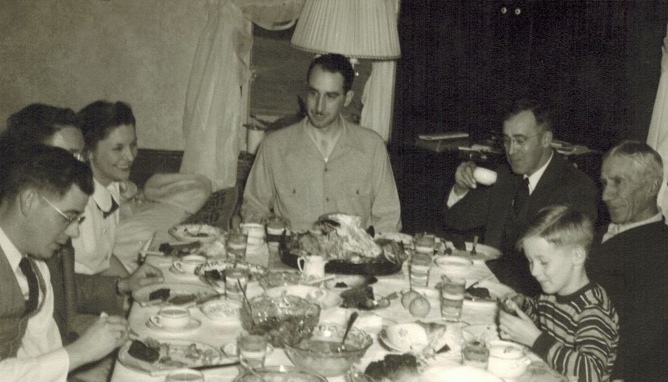 My handsome Uncle Wayne and family at a Thanksgiving table in the late 1940s.