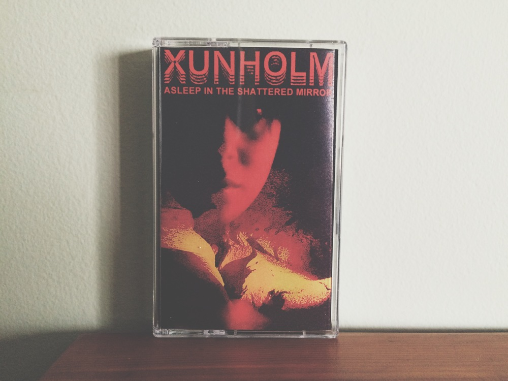 01. Xunholm - Asleep In The Shattered Mirror.jpg