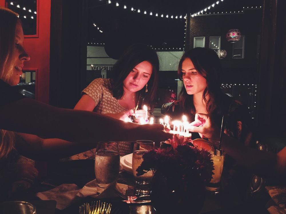 Here's a shot of us getting the candles lit on that amazing cake! Photo Cred: My friend Tory.