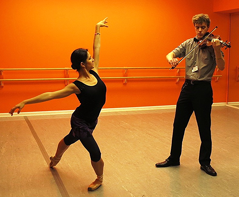 Olga Aru, prima ballerina with the Mosow Ballet, and Landon Oja, 2015 Wunderkind, Detroit Metropolitan Youth Symphony, during the 2015 rehearsal.