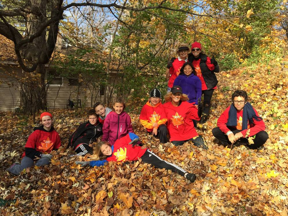 OLL students help with community Rake-A-Thon..