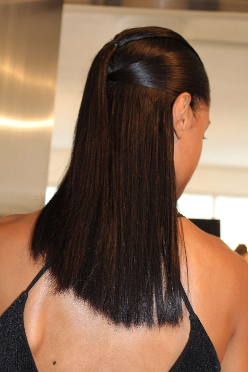 Backstage at Cushnie Et Ochs Moroccanoil made the hair all about angles and creating silky smooth strands. I'd rock this in real life.  Would you?