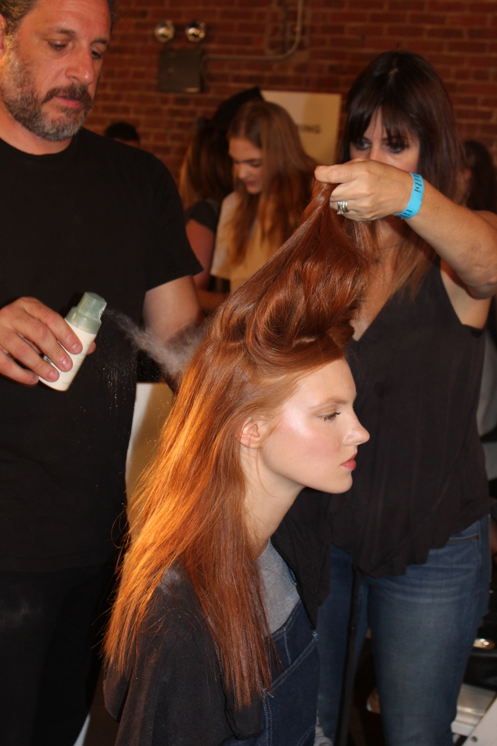 Team Aveda pumps up the volume on hair backstage at Tibi.  Tip: A little powder goes along way.