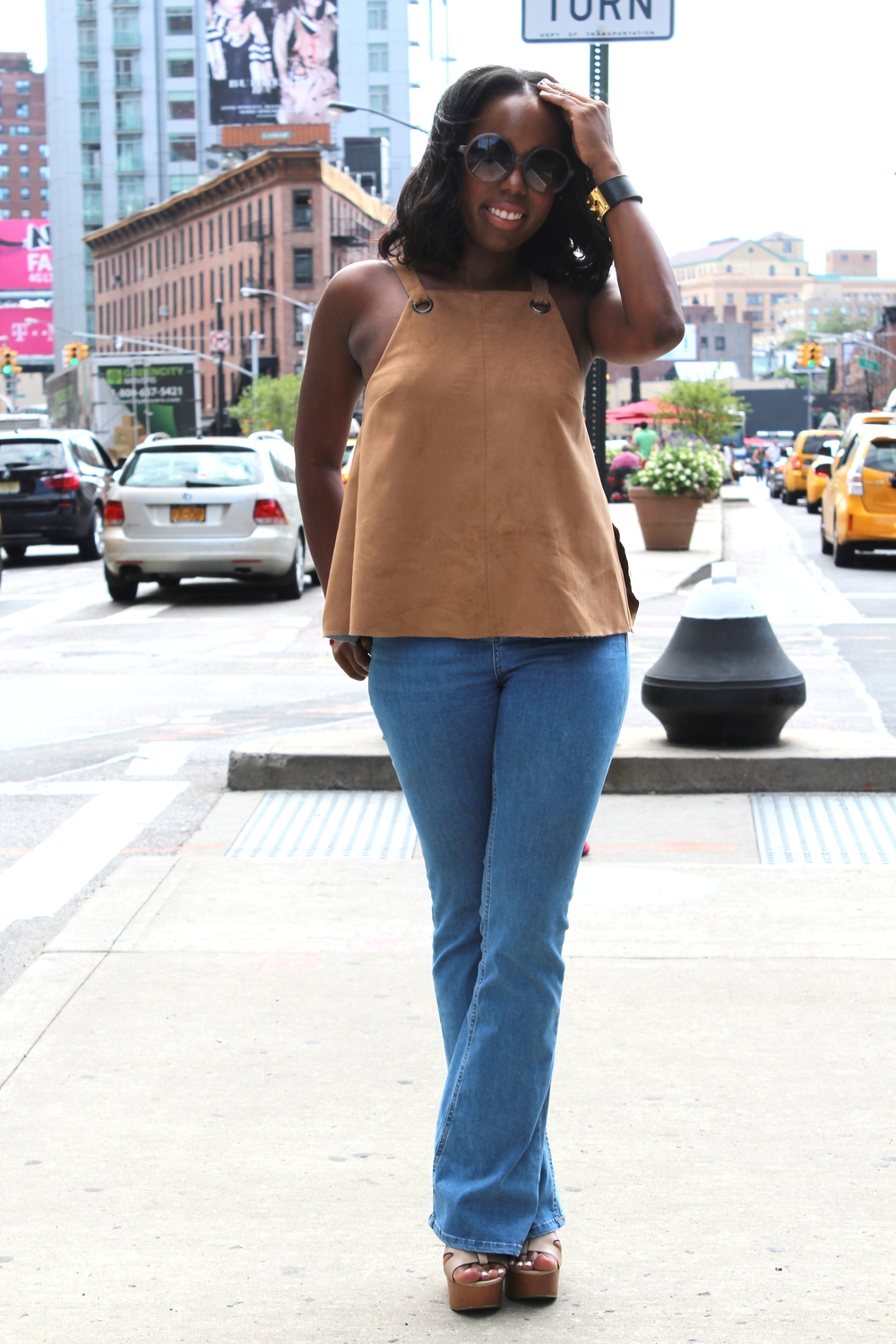 Here's to another season of NYFW! On one of my last days covering shows, I wore a 70s inspired suede tank and denim flares all from Topshop.