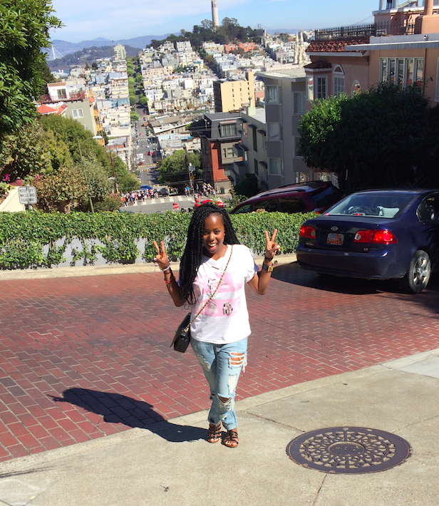 Sending good vibes at the top of San Francisco's famous, Lombard Street, a steep zig-zag street overlooking some of California's luxurious victorian style estates and mansions