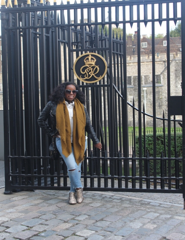 Striking a quick pose in front of the gates of The Tower of London