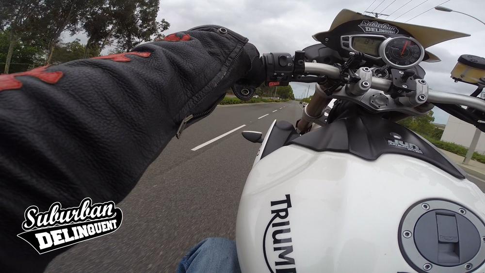 triumph-speed-triple-wheelie.jpg