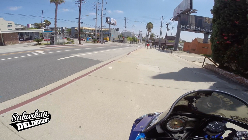 motoryclists-rides-on-sidewalk.jpg