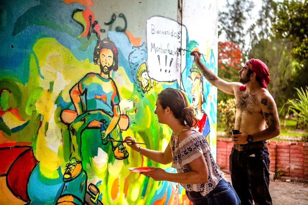 Chris and Katie painting a collaboration mural in Havana. Photo: Scott Furkay.