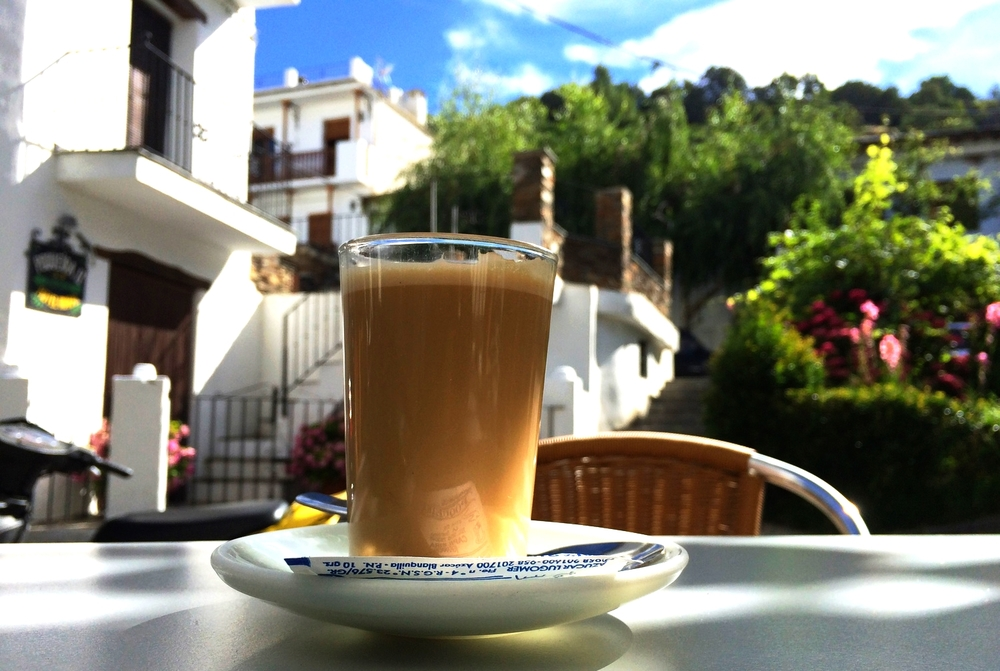 A classical presentation of a Cafe con Leche in a small town in the mountains of Andalusia.