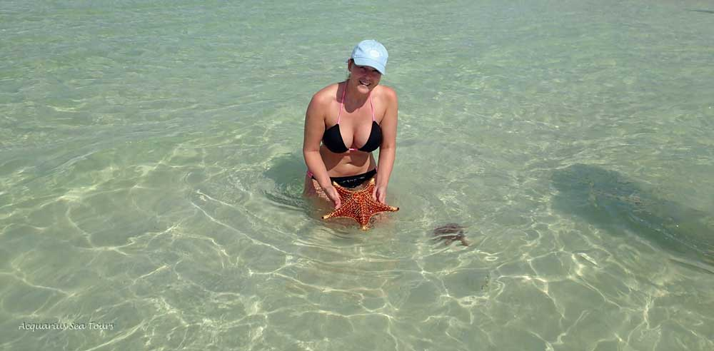 The sun breaks out for us at Starfish Point in Grand Cayman