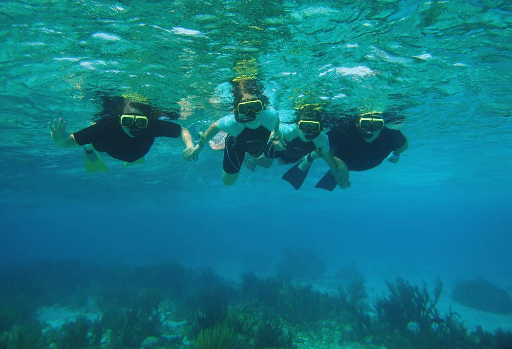 The family that snorkels together ...... Grand Cayman snorkel excursions