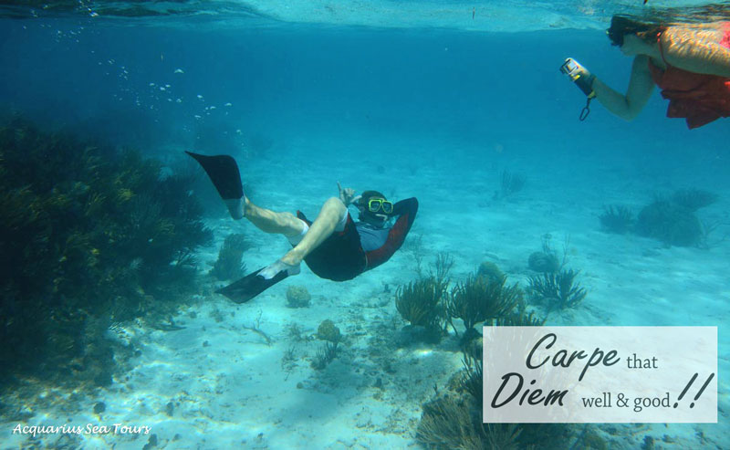 One of our guests giving the moment all he's got!! This was at the Coral Gardens in Grand Cayman
