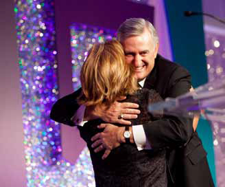 John Young, President and CEO, Energy Future Holdings accepts the Crystal Leadership Award from WBENC President and CEO Pamela Prince-Eason at the WBENC 2012 Summit & Salute.  Photography by visionista