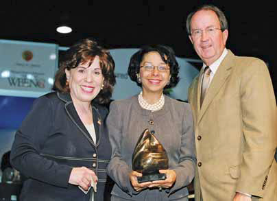 Susan Phillips Bari (left), President Emeritus, WBENC and William J. Alcorn (right), Chief Purchasing Officer, JC Penney Company, presenting the Applause Award to Sandra Rand (center).