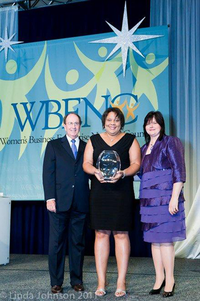 WBENC HONORS ERNST & YOUNG'S THERESA HARRISON (center) WITH WILLIAM J. ALCORN AWARD