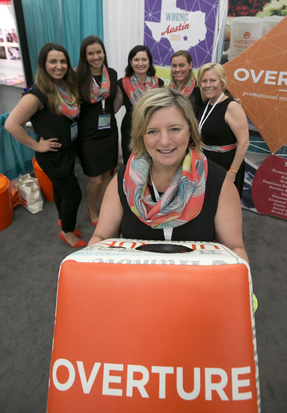 Heather Sanderson, the Founder and CEO of Overature Promotions with her team