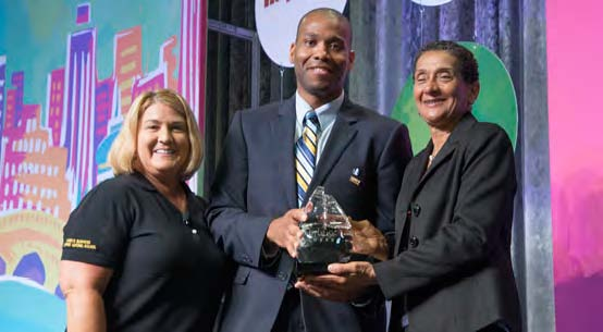 Presenting the Applause Award  Left to Right: Pamela Prince-Eason, President & CEO, WBENC; Frantz Tiffeau, Director of Supplier Diversity and Development, Nationwide Insurance; Benita Fortner, Chair WBENC Board