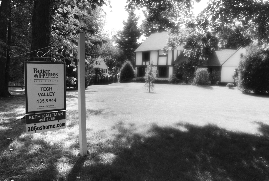 For Sale: Tech Valley.  306 Osborn Road Loudonville, NY 2011.   A seemingly arbitrary assertion: dial 435.9944 to unlock the gateway to Tech Valley (which according to the sign, lies just beyond this noble Tudor). By [re]dressing the traditional 'For Sale' sign, this provocative wayfinding° system aligns Better Homes & Gardens, 306 Osborn Road (as well as its past, present, and future 'owners'), and Tech Valley. The connotation? For Sale: A Byte of Tech Valley (formally known as the Hudson Valley).