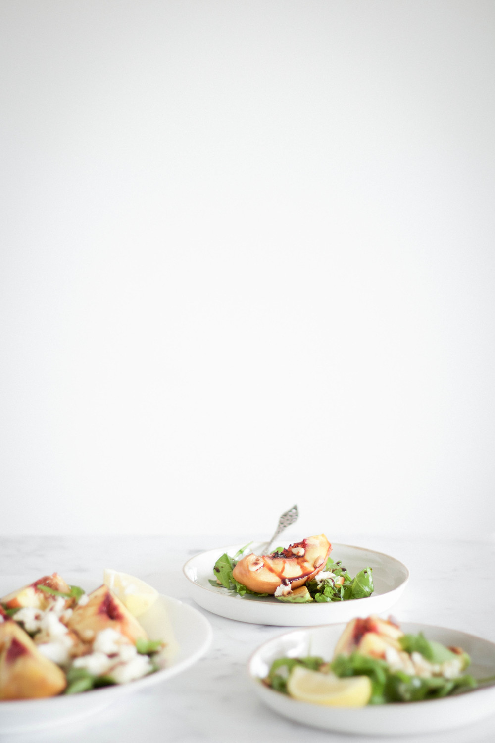 Grilled peach salad with mozzarella and avocado
