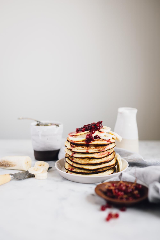 Lemon ricotta pancakes with redcurrant sauce