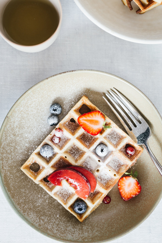 Buckwheat waffles w/ berries & plums