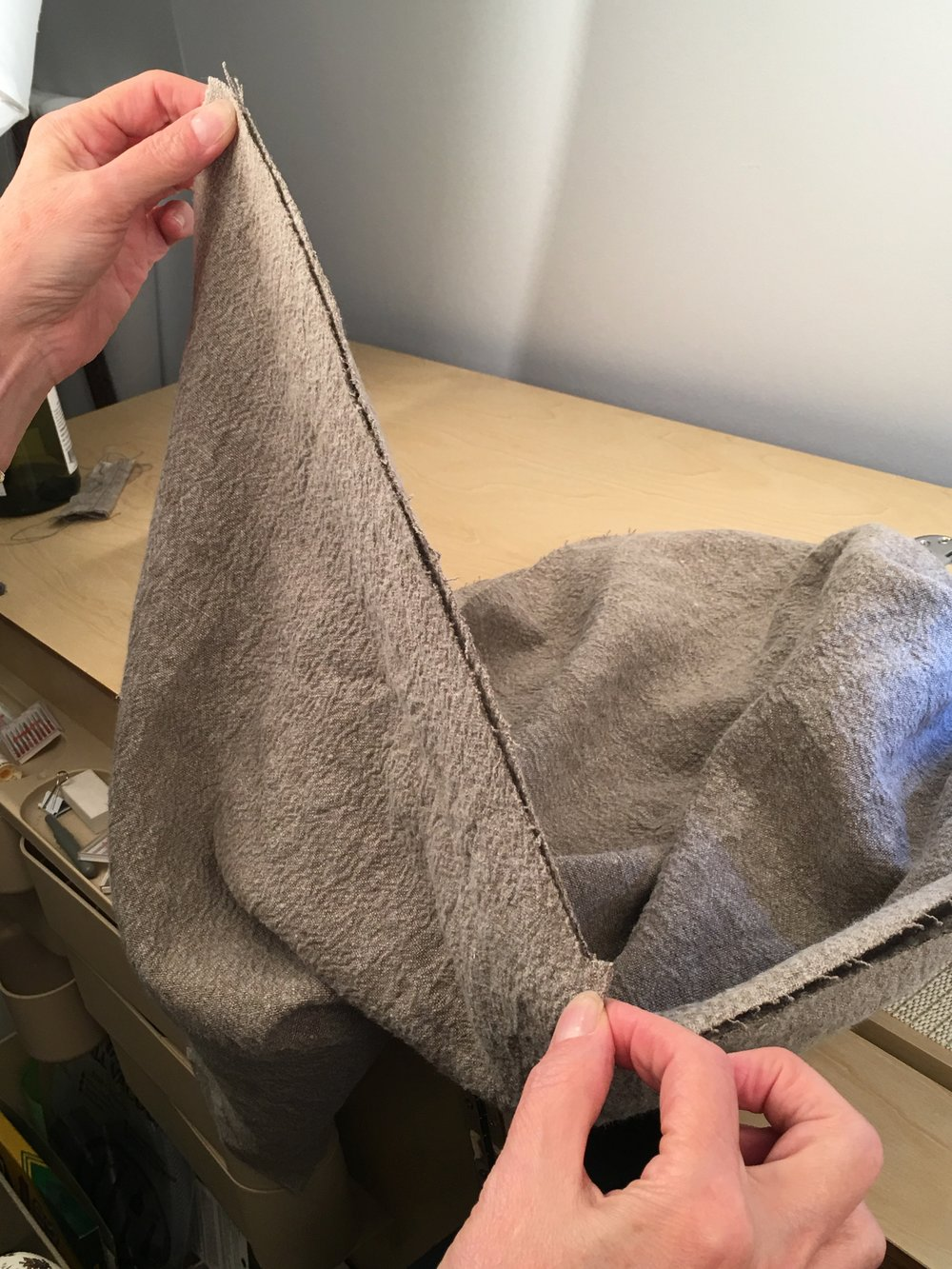 Make sure hem edges are even, and underarm seams are lined up. Pin if necessary.