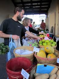 Shopping at farmers' markets helps to support local producers.