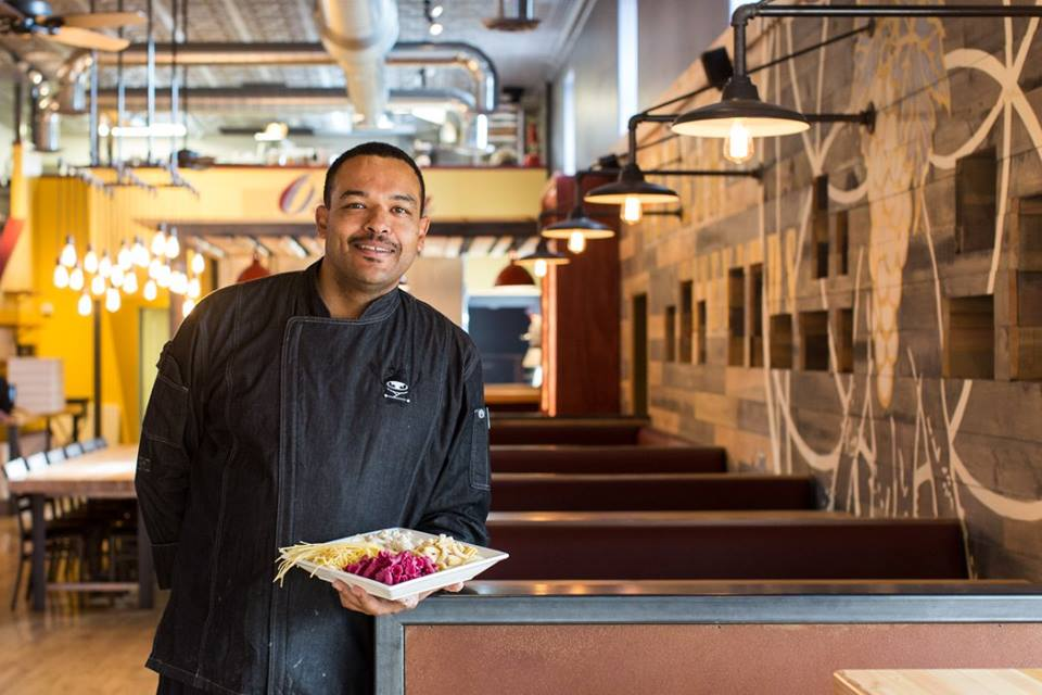 Chef Christopher Smith creating food, delighting the tastebuds