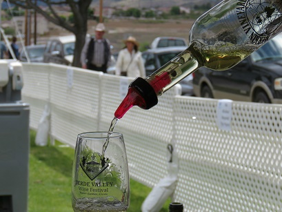 A festival attendee enjoys a sample of Merkin Vineyard's Shinola Blanca.