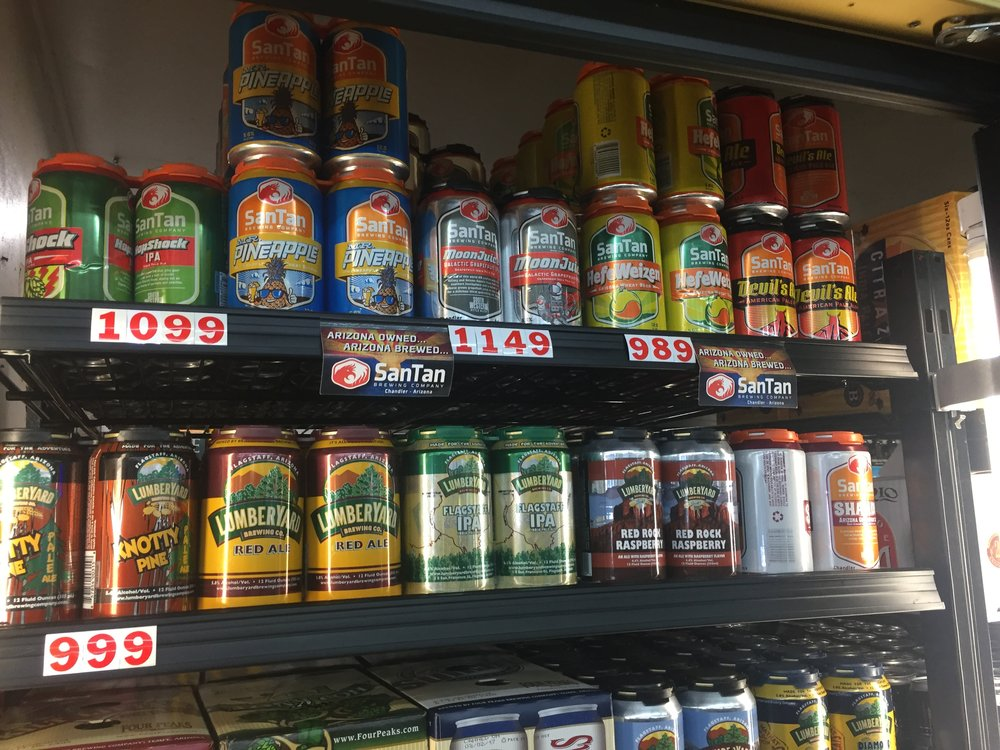 Local beers like the Lumberyard's Red Ale and San Tan's Devil's Ale line the refrigerators at the Suzy Q Market