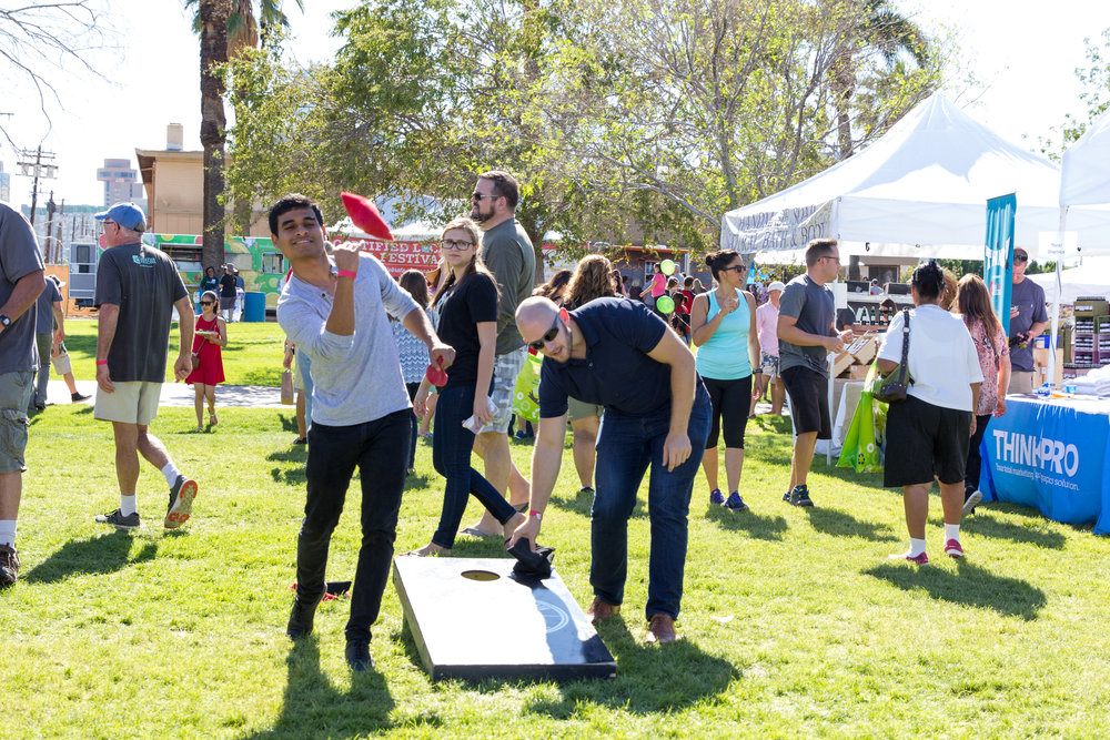 Attendees play corn hole at the 2016 Fall Fest. Credit: Harrison Lai Photography.