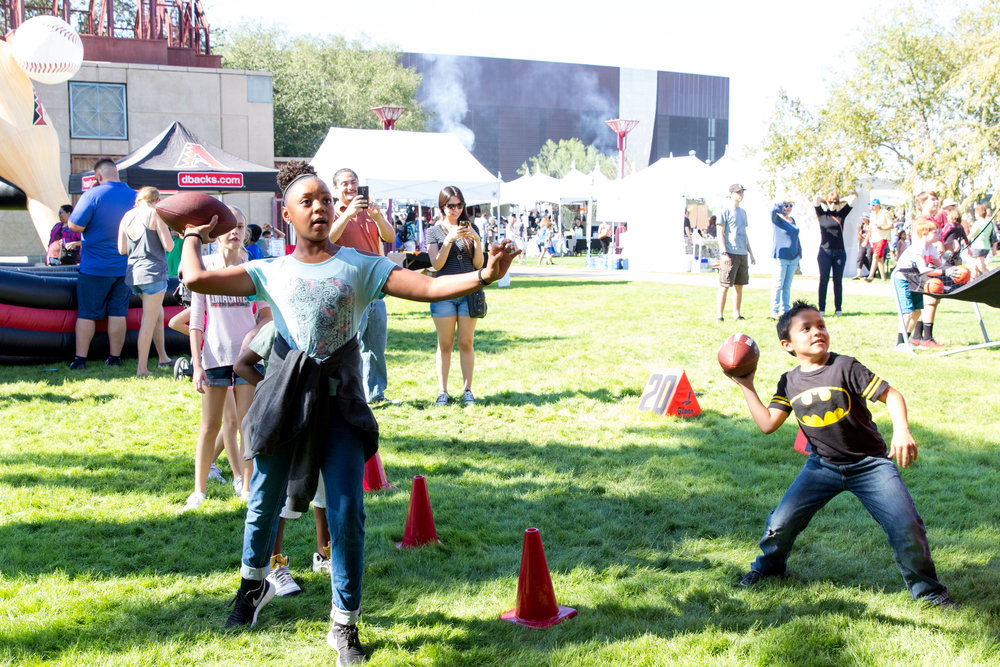 Kids play in the sports zone of the 2016 Fall Fest. Credit: Harrison Lai Photography.