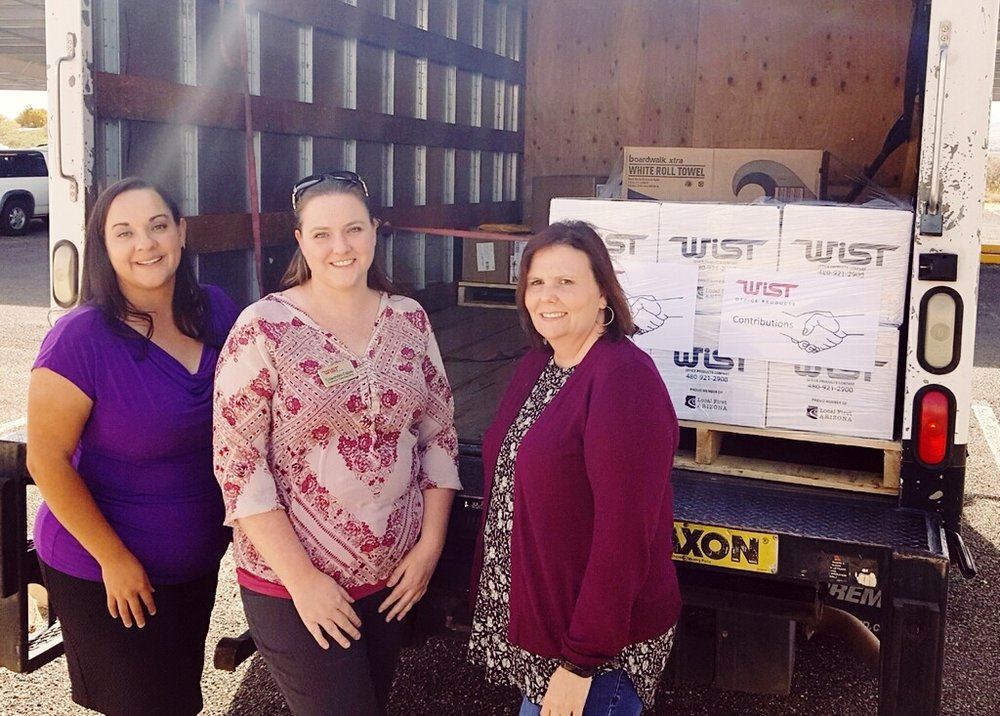 Cassie Capas, a Wist Office Products customer service executive, assisting with a donationdelivery to the City of Bisbee after the fire at their City Hall.