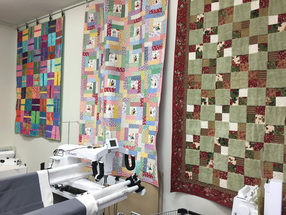 Ready Made Quilts Custom made quilts and other one-of-a-kind pieces are available for purchase including hand bags, clothing, accessories and small and full size quilts that are displayed throughout the space. Made as samples for display or during one of the professional classes, these incredible masterpieces are collectible works of art.