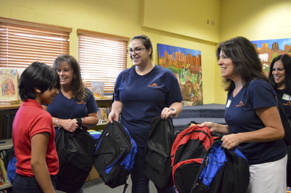 CopperPoint employees hand out backpacks during Pack to School.