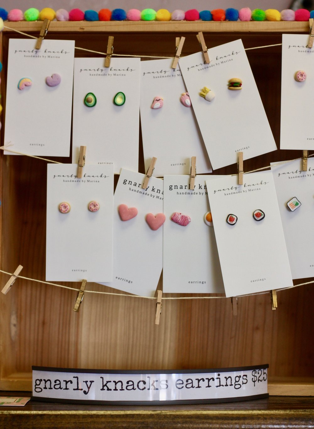 Dedicated supports local artisans by selling their handmade goods, including these adorable food-inspired earrings, at the bakery.