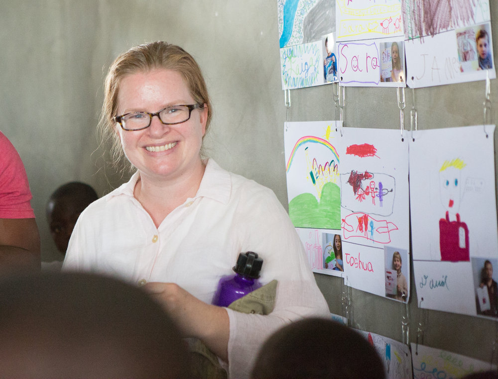 "Kristy Gordon, sociologist and educational consultant, Lilburn, Ga.  Kristy supports the EcoVillage School because she feels that all of God's children deserve to be heard and understood.  ""I had learned a lot about Haiti, but I didn't really understand.  Traveling to Haiti and hearing the stories of the people helped me better understand their lives, and even more, to know their hopes for the future.  I will never forget the things I learned from my new Haitian friends.  I hope that sharing stories of Haitian struggles and dreams of a better tomorrow will inspire others to help."""