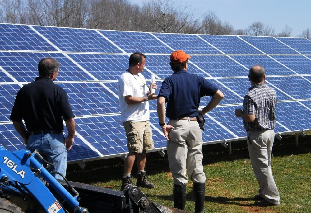 Bernie explains solar to inspectors from Powhatan.jpg