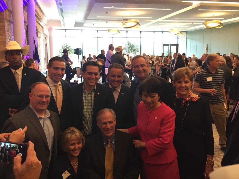 WE ARE UNITED!              State Representatives gather around              Governor Greg Abbott