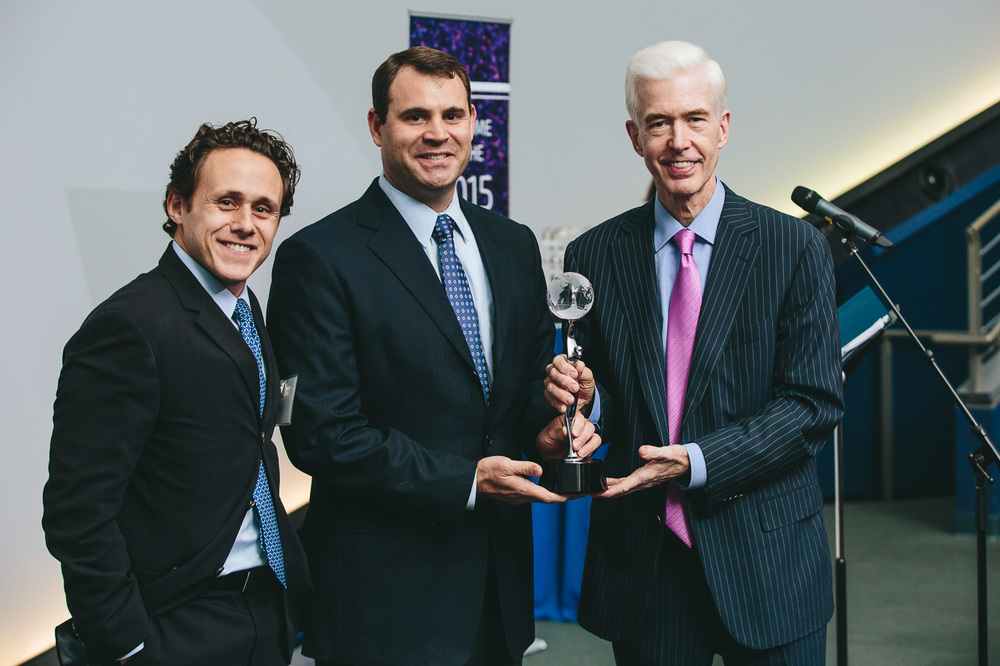 Governor Gray Davis (R) presents the award for Early-Stage Investor of the Year to Dolby Family Ventures, represented by David Dolby (center) and Andrew Krowne (L)