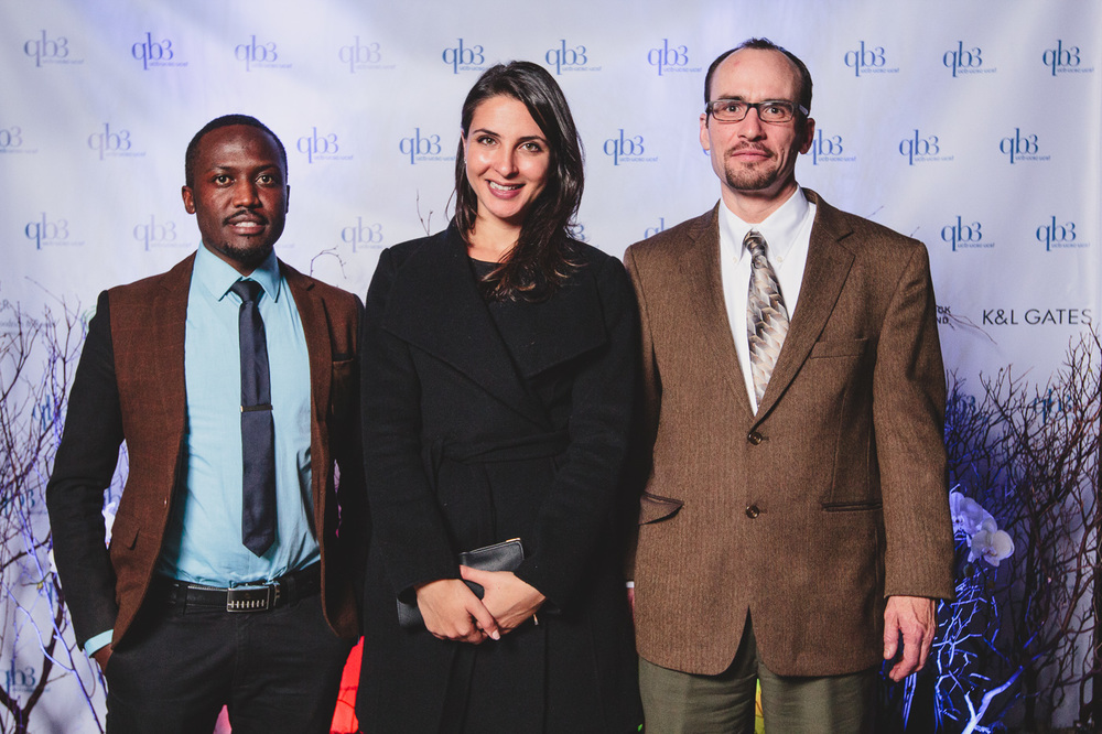 Christopher Ategeka (L) and Anwaar Al-Zireeni (center) of Privail with Kaspar Mossman of QB3 (R)
