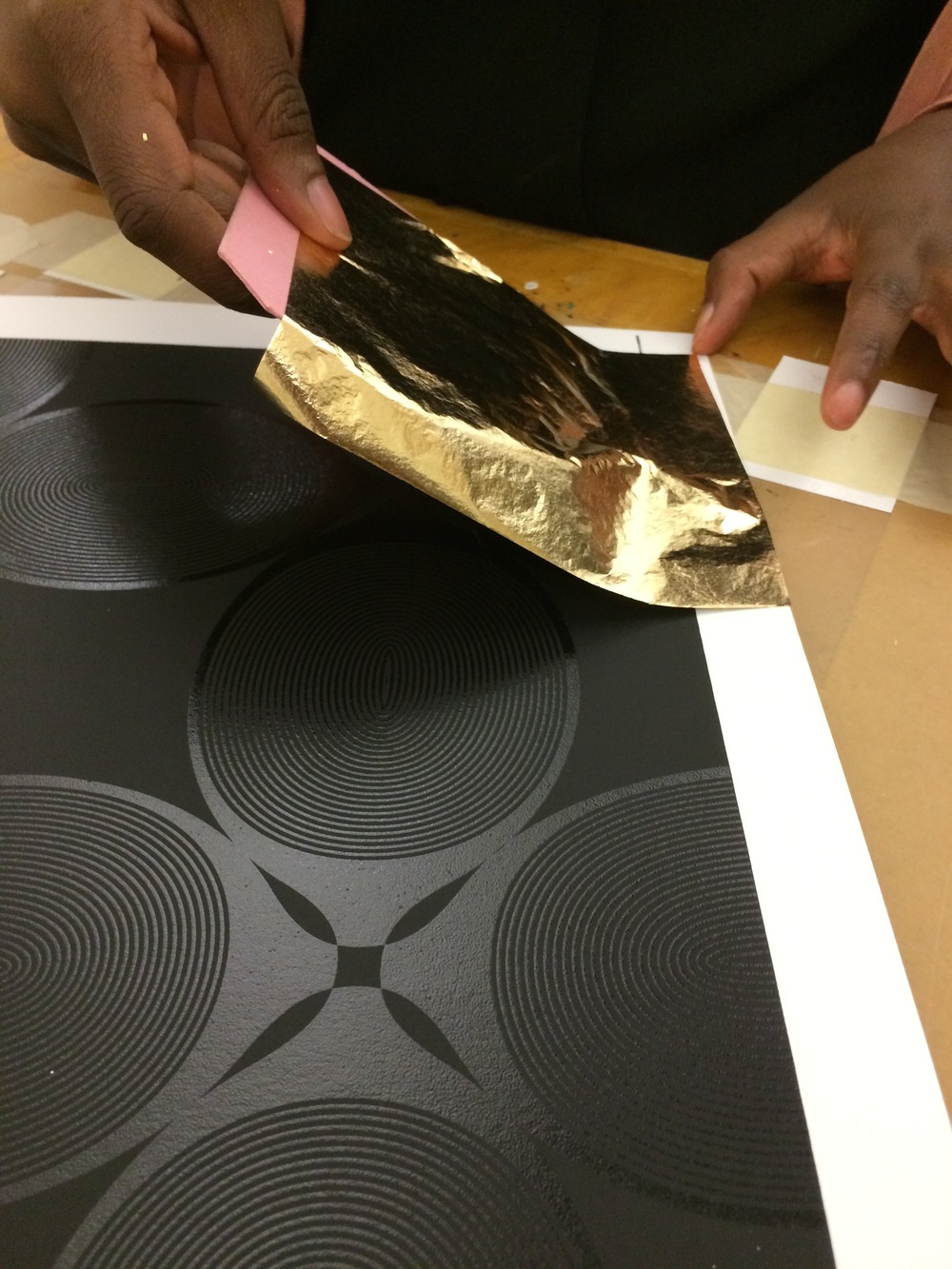 Applying gold leaf.jpg