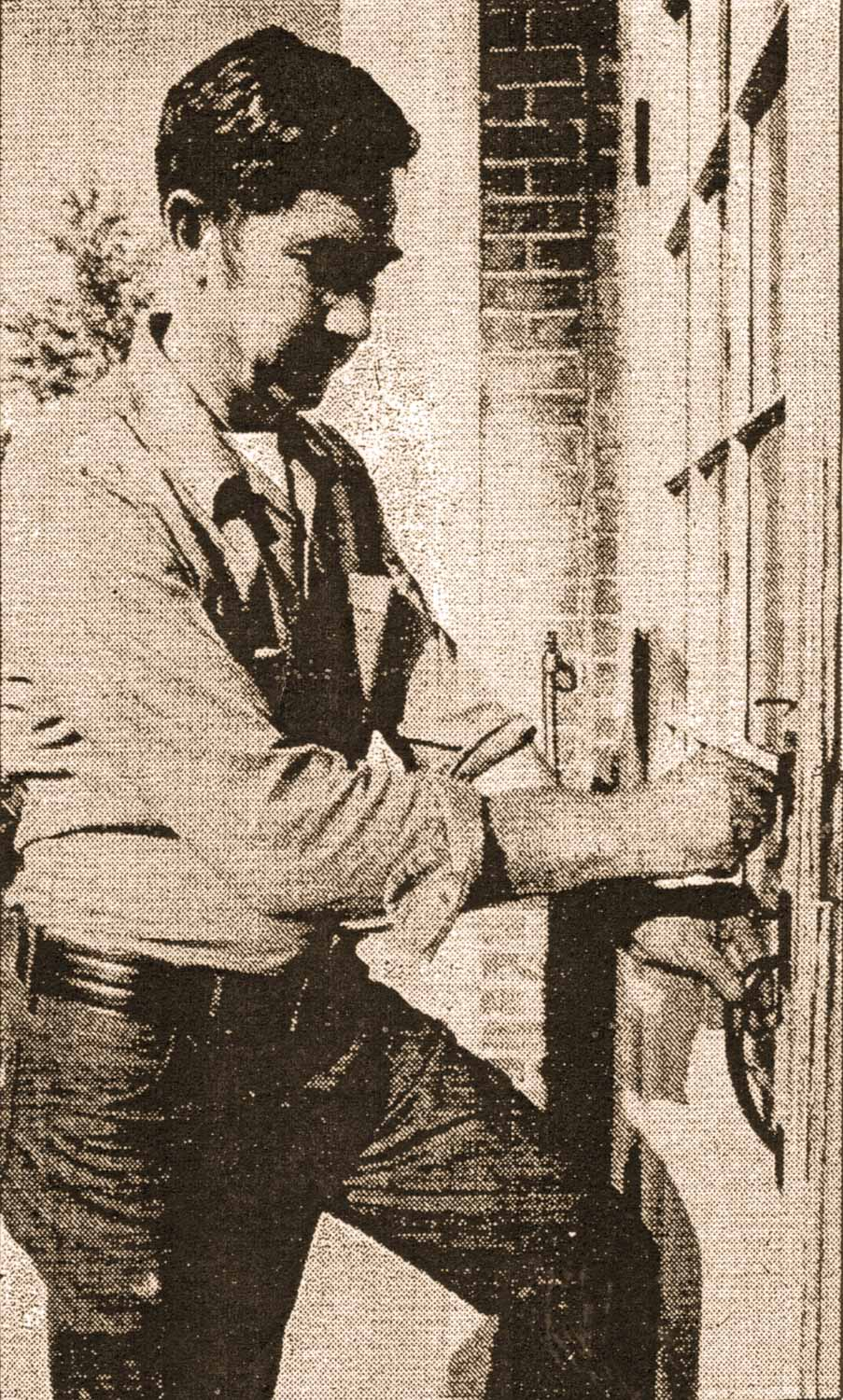 Locksmith John Drabick locks the Hudson Training School administration building for the last time. Source: Hudson Register-Star, September 11, 1975.